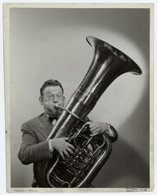 tuba player with cheeks and eyes bugging out