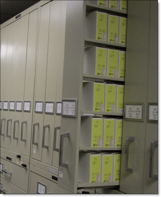 Drawers of microfilm, one opened