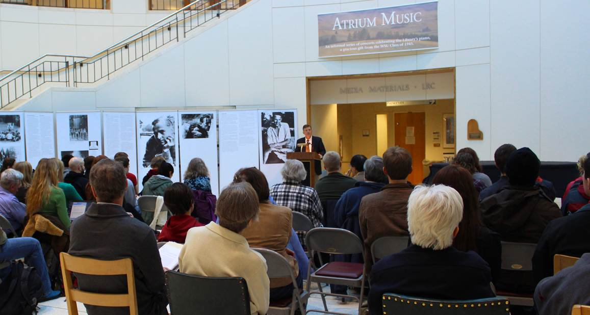 audience seated before a speaker at a podium in the WSU Terrell Library rotunda