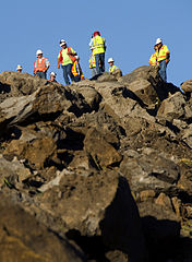 road blasting crew standing on a pile of rocks