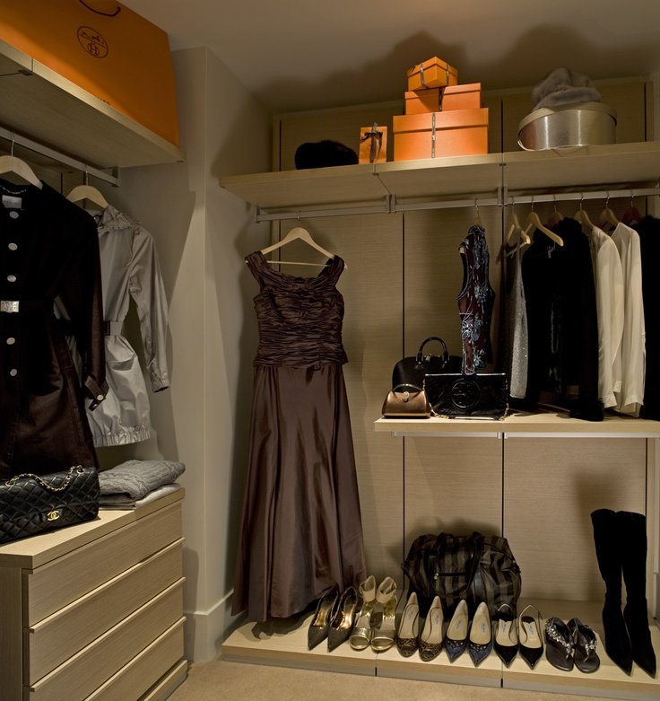 closet of women's clothes and shoes