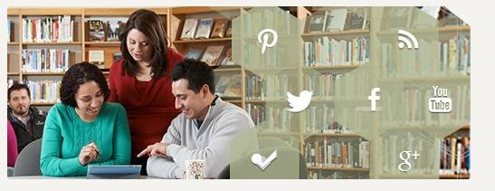 Image of students working together in a library