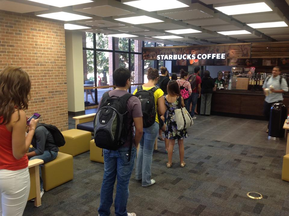 photo of patrons standing in line at Starbucks