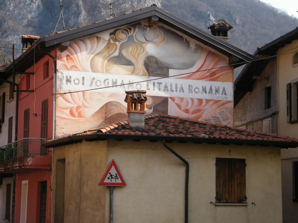 "Image of Facist propaganda slogan, ""We dream of Roman Italy"""