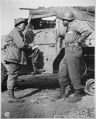 War correspondent interviewing serviceman in World War II.