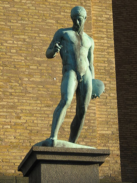 Statue of man holding discus