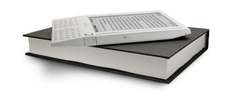 Kindle on top of books