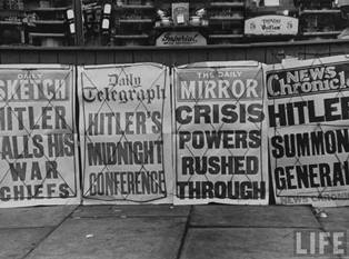 A view of newspapers screaming headlines of war during the outbreak of World War II.
