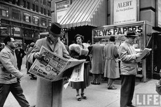 People buying out of town newspapers in Times Square during newspaer strike.