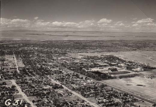 Aerial Photograph of the UNM campus from the southeast; volcanic escarpment on horizon.