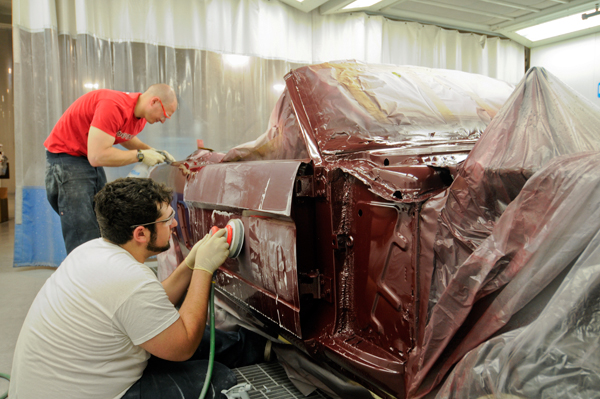 students restoring Ford Mustang