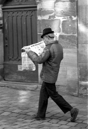 man reading newspaper; taken from Wikimedia Commons