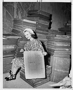 UW student Lorraine Lowder showing Seattle Star newspaper, ca. 1940. Special Collections, UW Libraries, UW19966x.