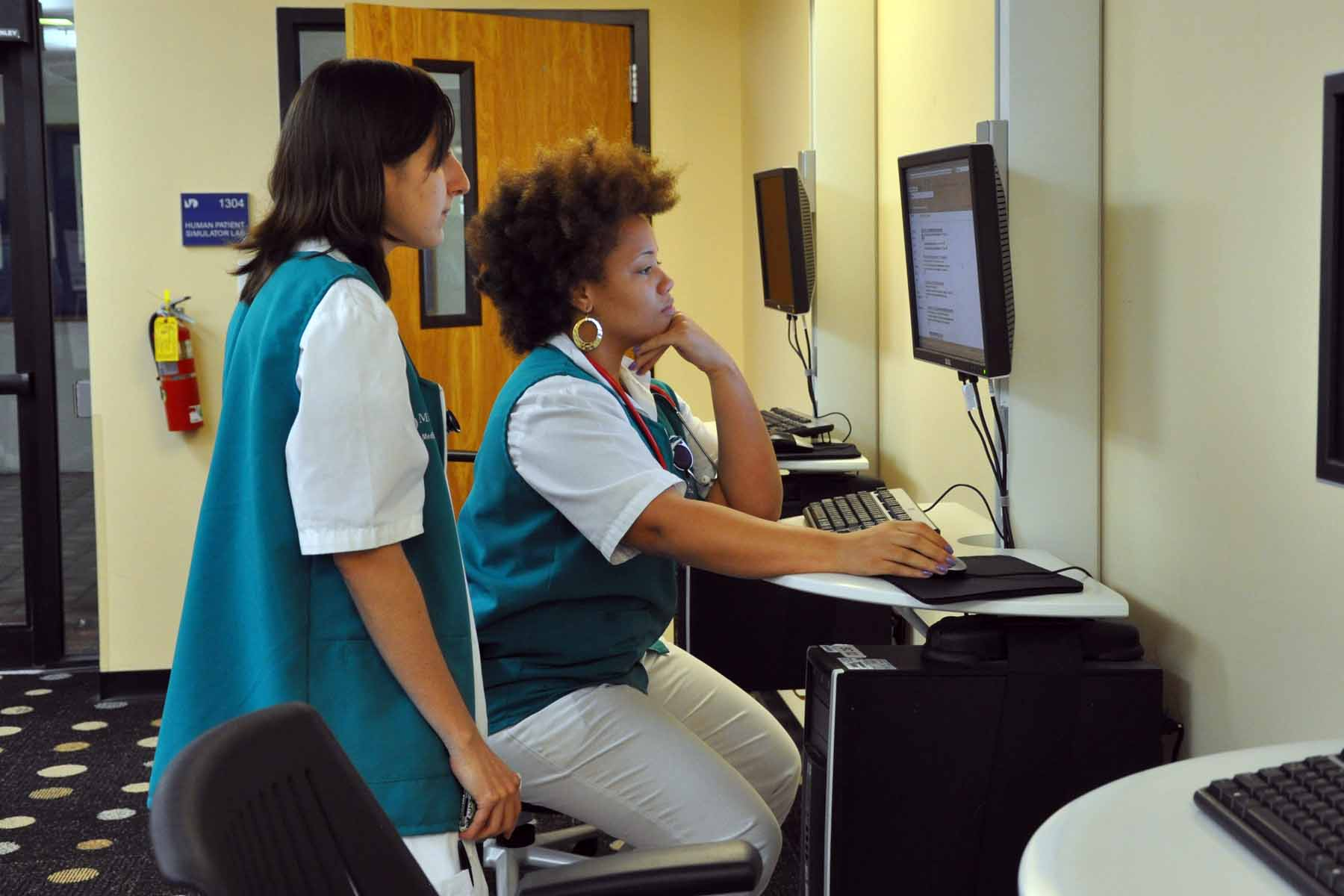 Students using a computer at the Success Center Medical Campus