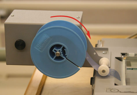 a spool being loaded into the microfilm