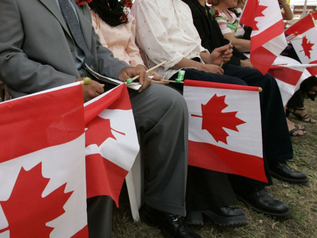 immigrants with Canadian flags