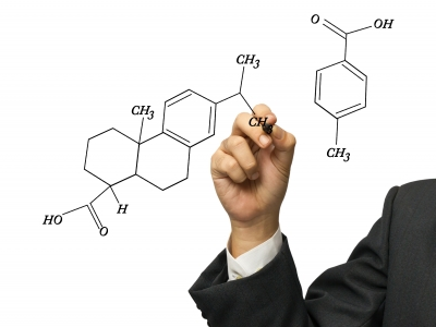 stock photo of a hand with a pen drawing a chemical diagram, from https://www.freedigitalphotos.net