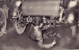 Female mechanic repairing a car Illustrated war news May 24, 1916 Pt 94 p28.