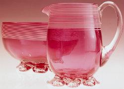 Cranberry glass creamer and bowl English Mark Strizic. H2008.11/428 UK design class 11-02  'glassware'
