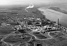 An aerial image of a nuclear power plant in black and white