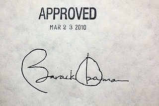 "Barack Obama's signature beneath a stamp that says ""Approved Mar 23 2010"""