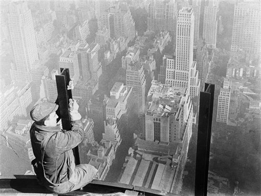 A man takes in an aerial view of the city of New York City, 1931. (AP Photo)