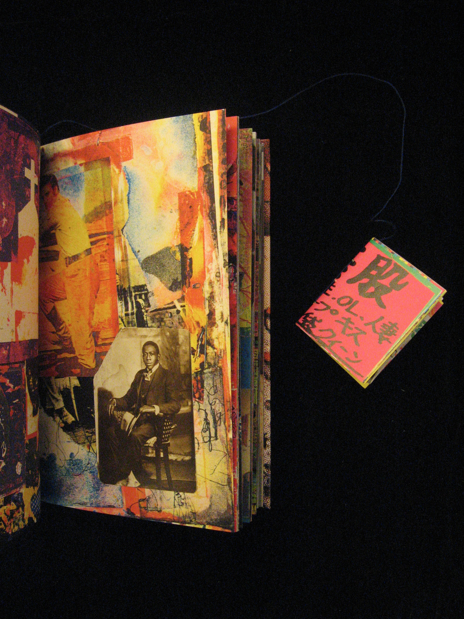 Page spread with colorful collage and a small, detached booklet.