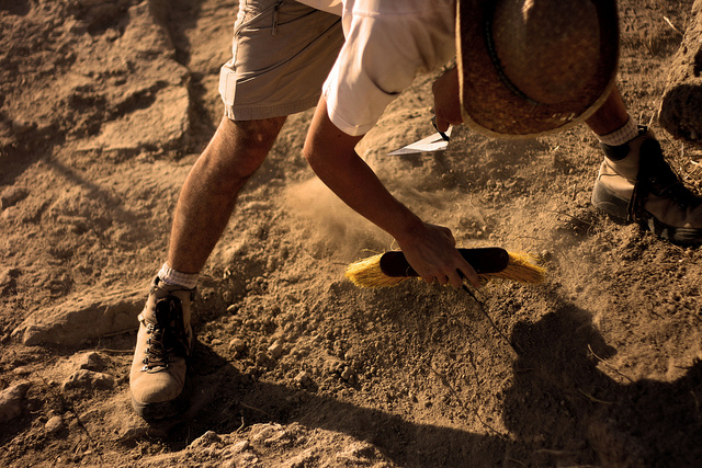 Man working at an archaeological dig