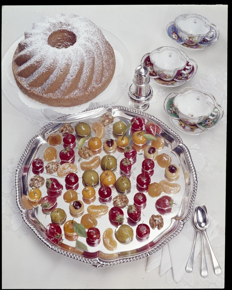 Kugelhupf cake recipe ready to serve with Friandises on George II salver. Image copyright Mark Strizic