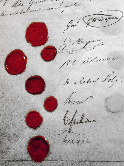 A series of signatures with seals in red wax. the writing is illegible.