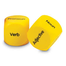 yellow dice with parts of speech words on them