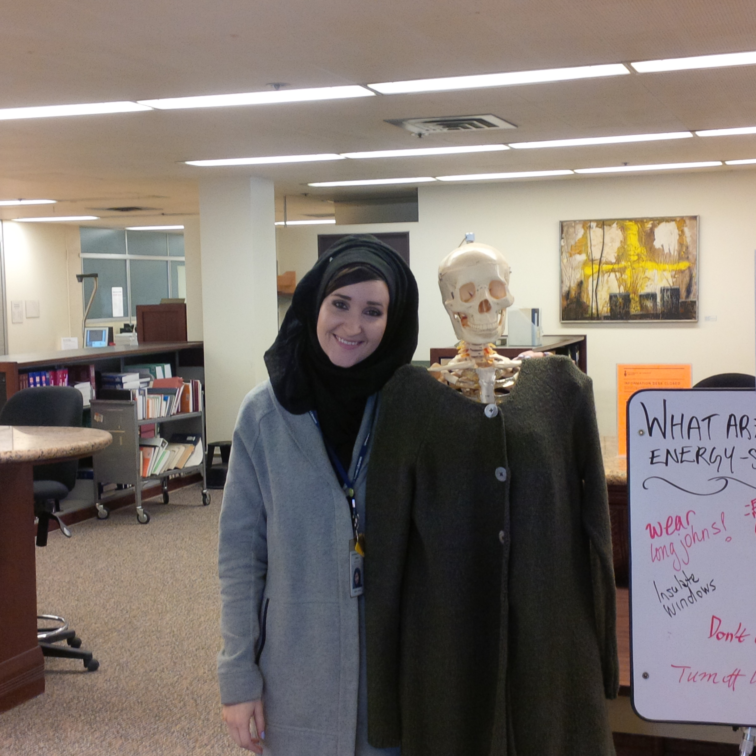Another student with Skully, wearing long, grey sweater